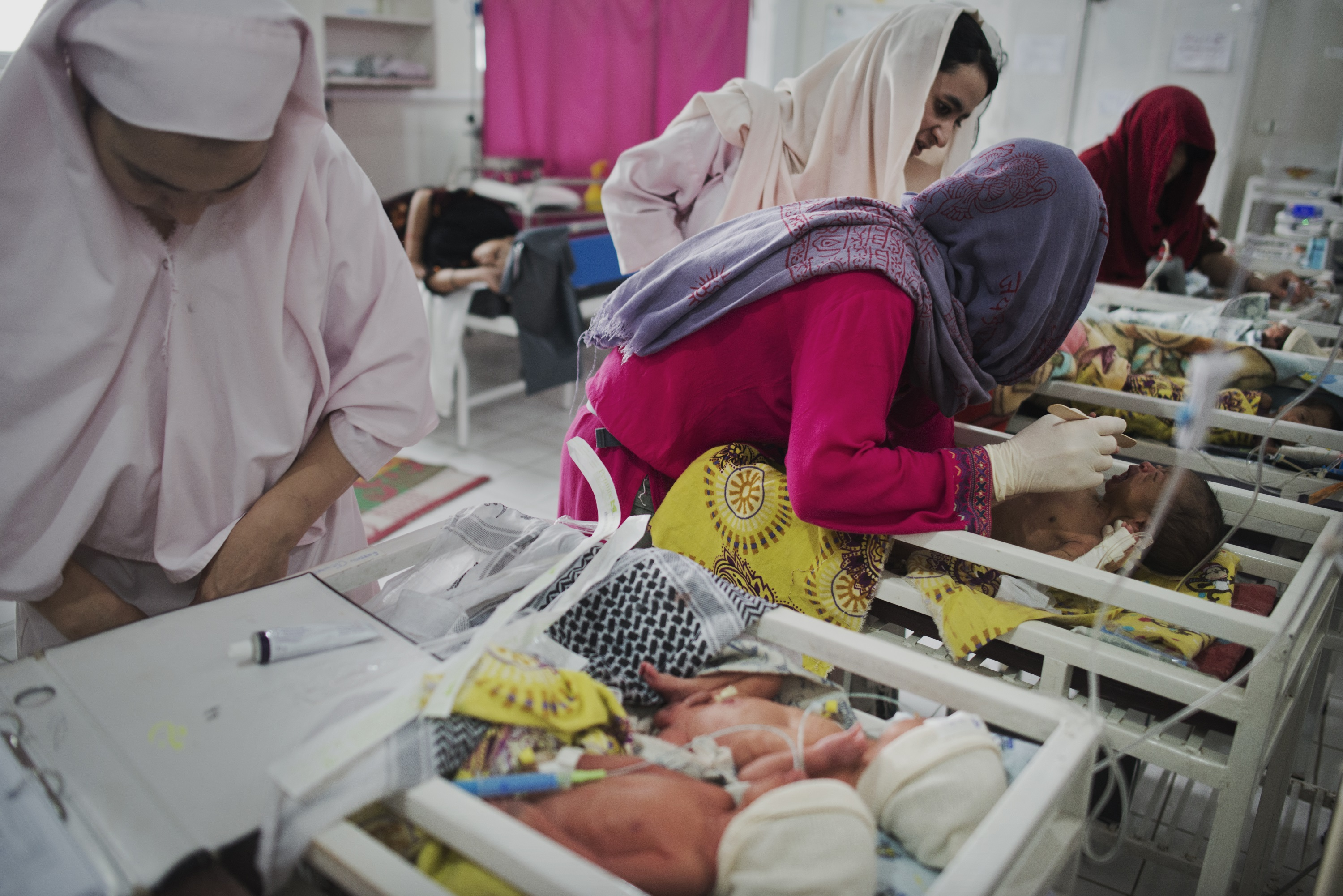 A newborn is examined by Pediatric Nurse Isabelle Arnould and midwives in the neonatal ward of the MSF Maternity Hospital in Khost, Afghanistan.