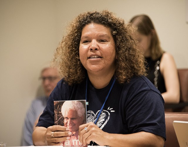 Karina Lester shows a photo of her father Yami Lester at the recent UN negotiations for a nuclear ban treaty.