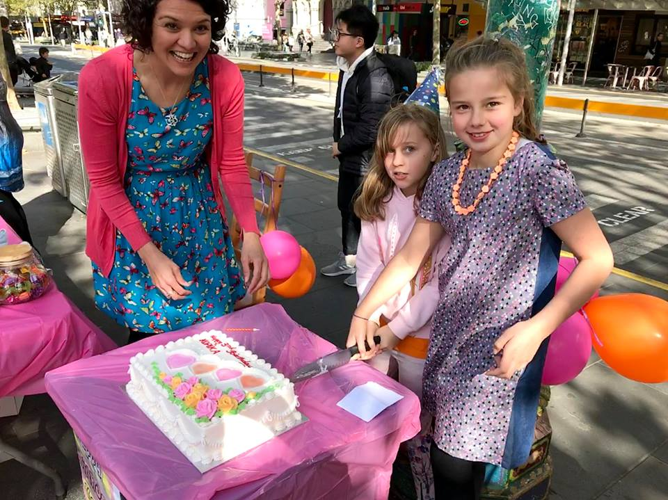 Isabelle Cameron (R) with her mother Simone and friend Mia, with Kopika's birthday cake