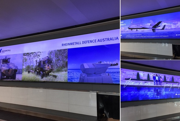 Advertisements at Canberra Airport. Photograph taken May 2018, by Melissa Sweet