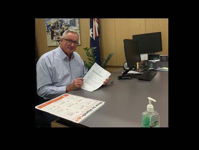 NSW Health Minister Brad Hazard signs the order on 30 March. Photo via @BradHazzard