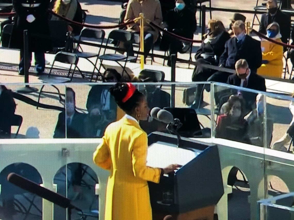 National Youth Poet Laureate, Amanda Gorman, at the Presidential Inauguration. Still from NBC News on YouTube