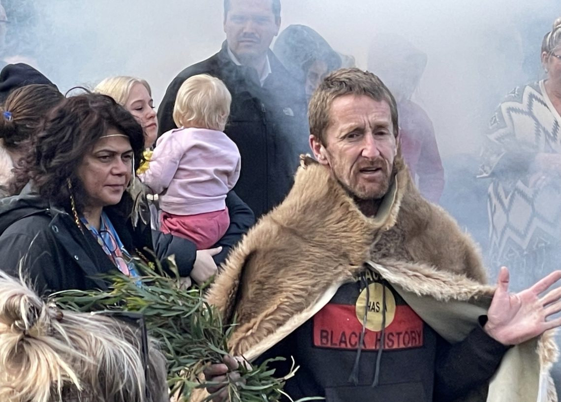 Jason Smith talks about the importance of cultural burning for healing country and future generations, at a NAIDOC Week event in southern lutruwita, Tasmania, 5 July. Photo by Melissa Sweet