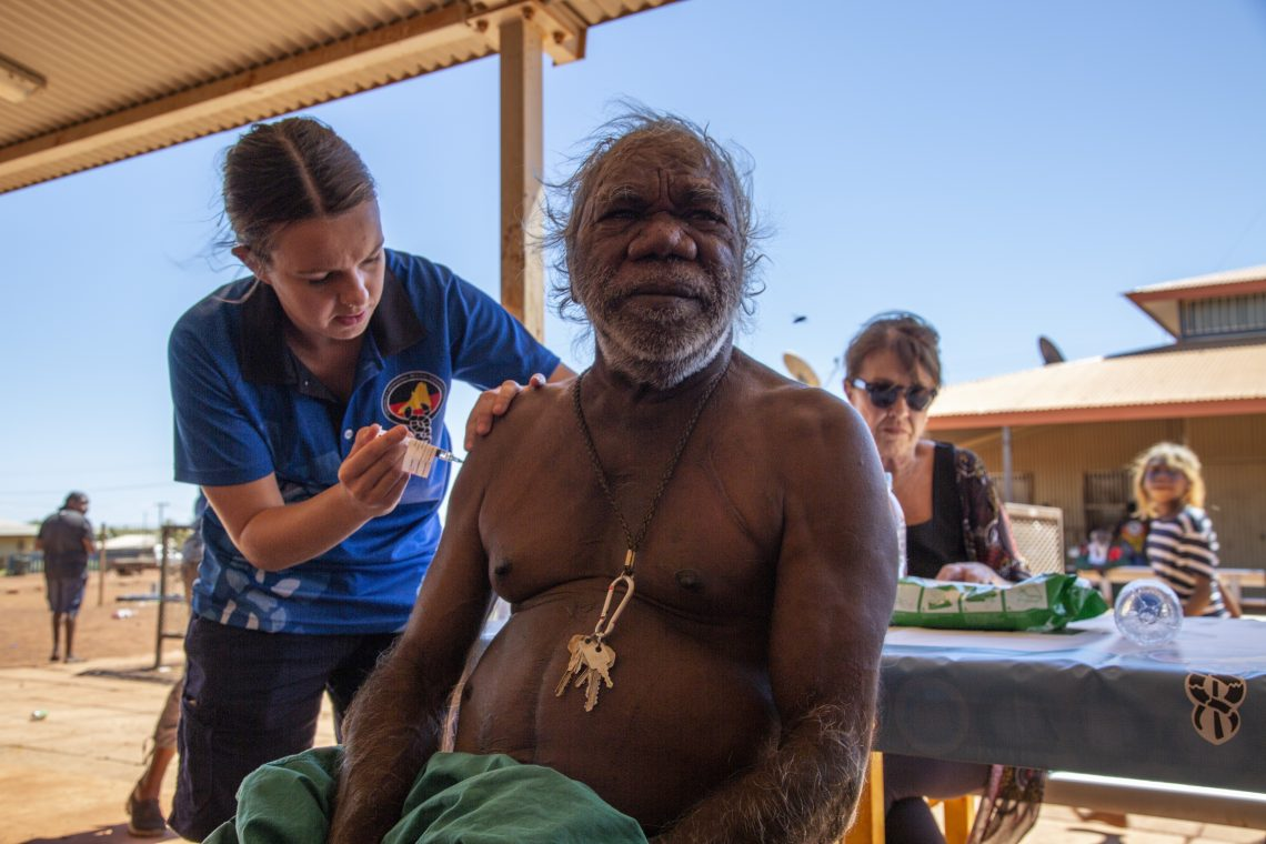 A remote area nurse administers a COVID-19 vaccine to a Balgo community member in Western Australia. Photo supplied by Kimberley Aboriginal Medical Services