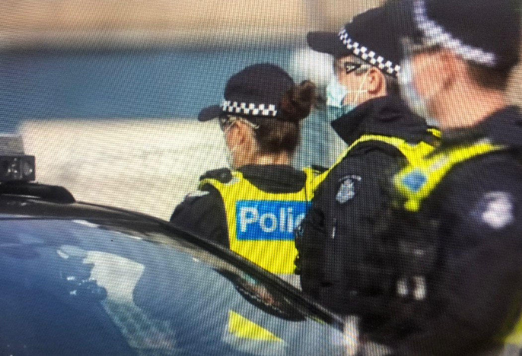 Screenshot from coverage of police presence at the hard lockdown of Melbourne public housing towers in July 2020