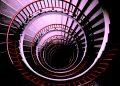 A downward spiral. Photo by Tine Ivanič on Unsplash