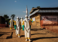 How many lives could have been saved with much earlier detection of Ebola? MSF hygienists in Sierra Leone during the Ebola outbreak in December 2014. Photo courtesy Anna Surinyach/MSF